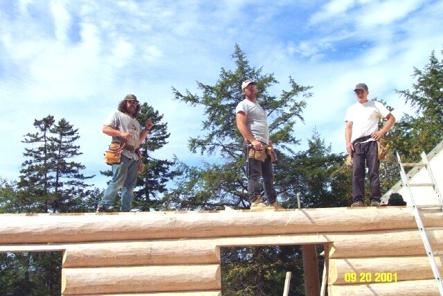 Jeff, Jason, and Tony assembling a log home at Tucker Mountain Log Homes in 2001.